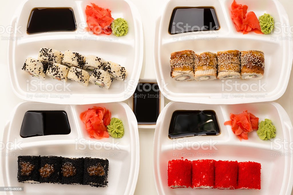 four rolls serving plates in top view stock photo