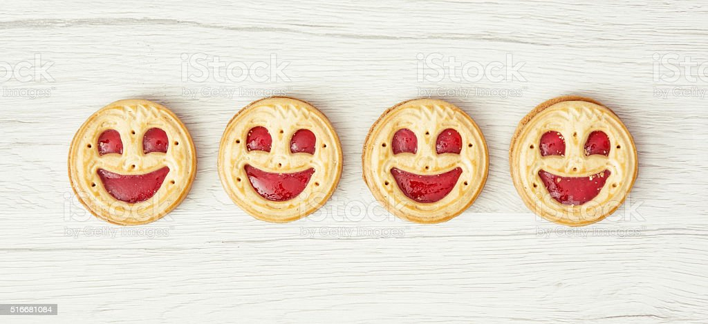 Four round biscuits smiling faces stock photo