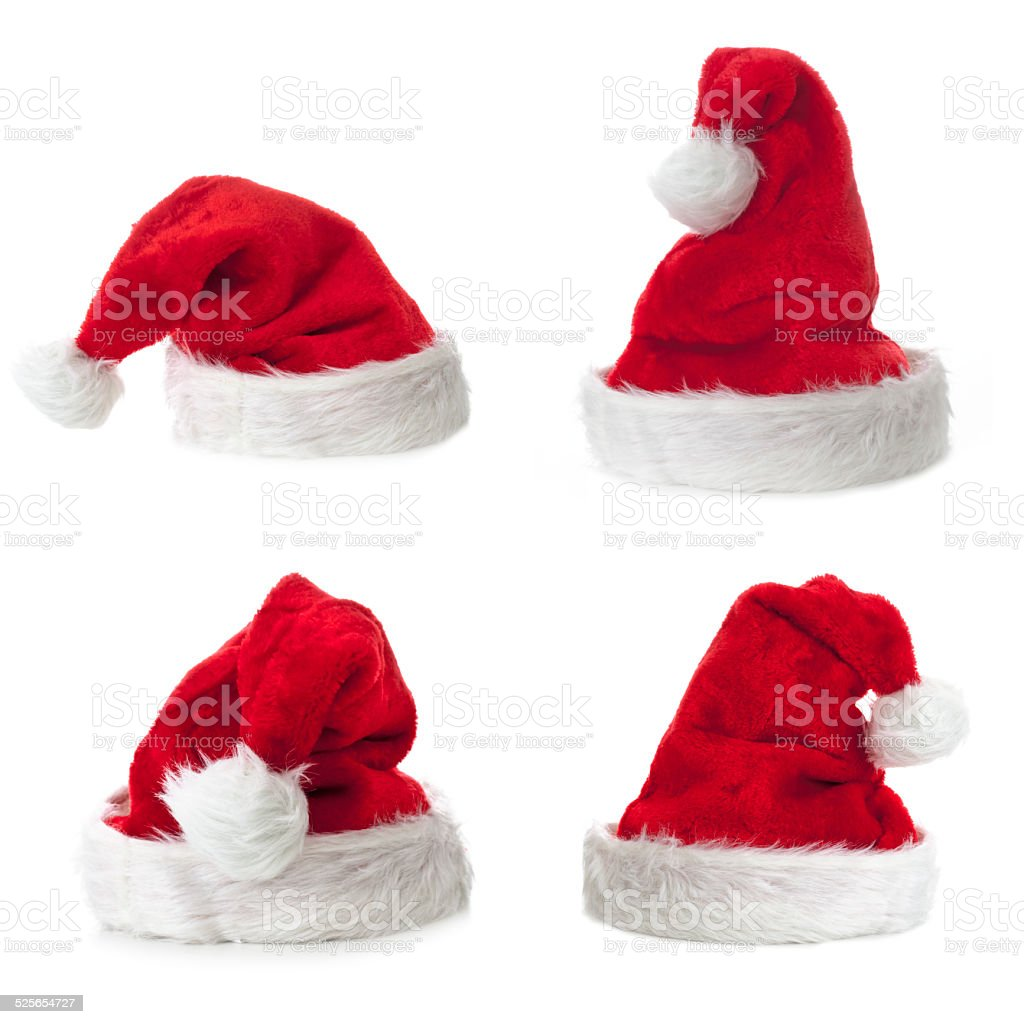 Four Santa Claus hat on white background stock photo