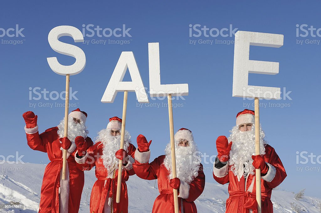 Four Santa Claus stock photo