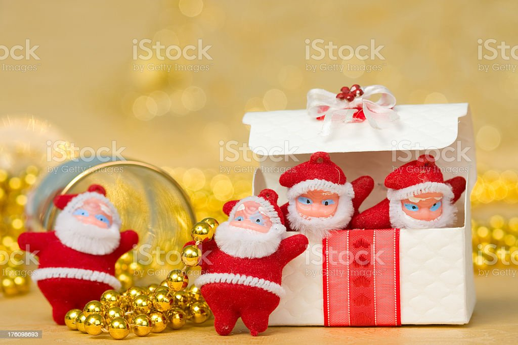 Four Santa Claus with gift royalty-free stock photo