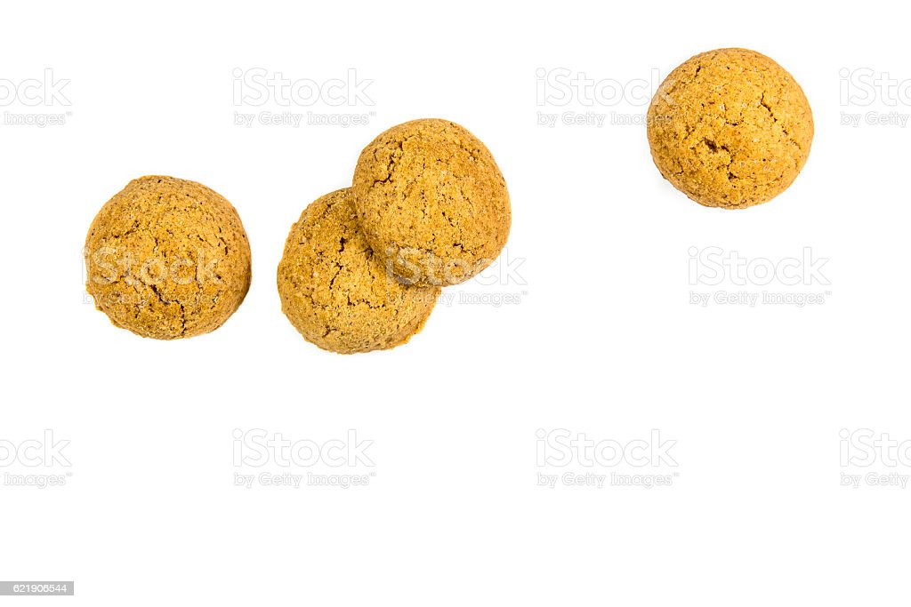 Four scattered ginger nuts in a row stock photo
