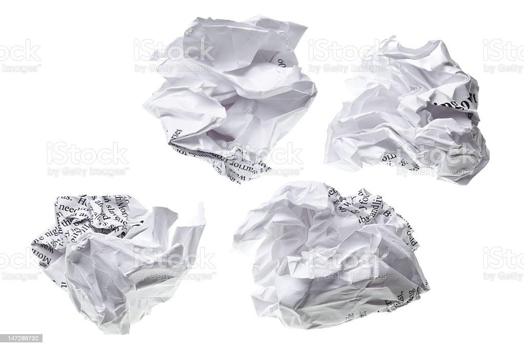 Four scrunched up pieces of white printed paper  royalty-free stock photo
