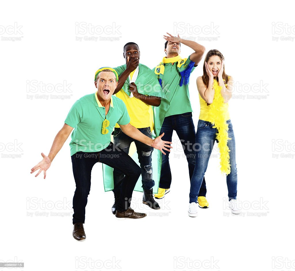 Four shocked Brazilian soccer fans unimpressed by team performance! royalty-free stock photo