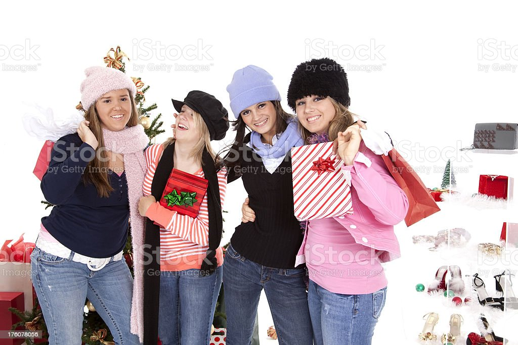 Four Silly Teenage girls shopping for Christmas carrying gifts royalty-free stock photo