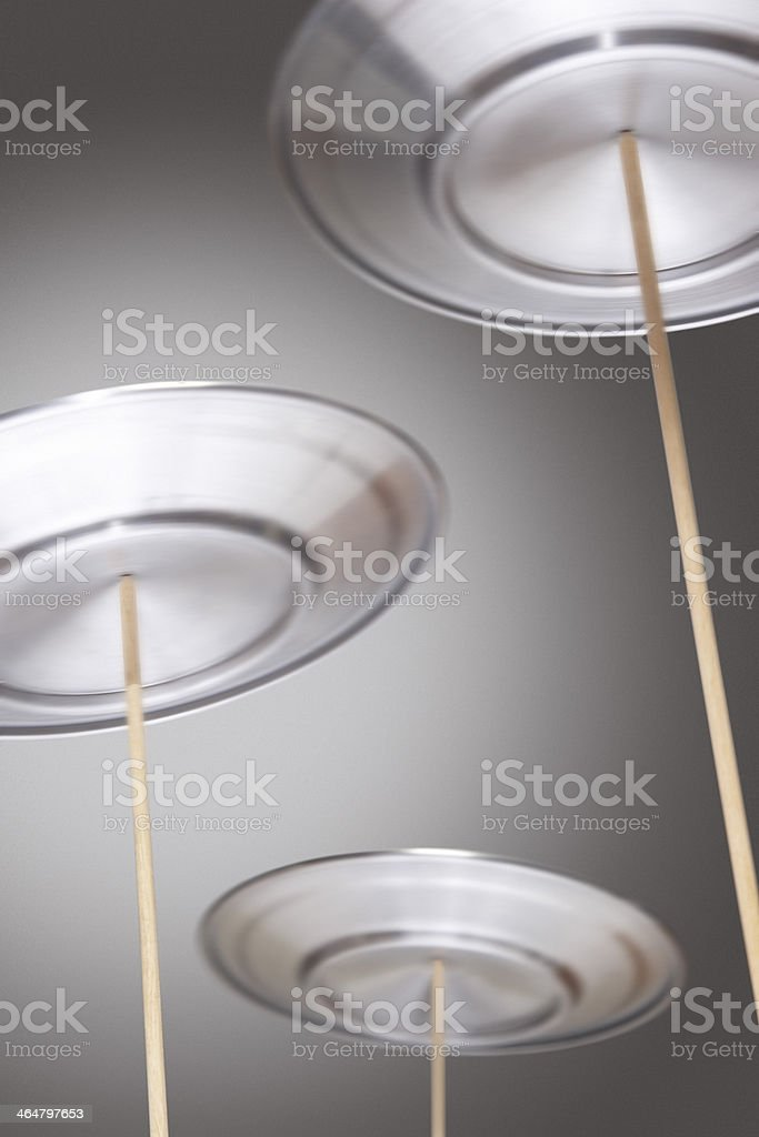 Four silver plated spinning on wooden sticks stock photo