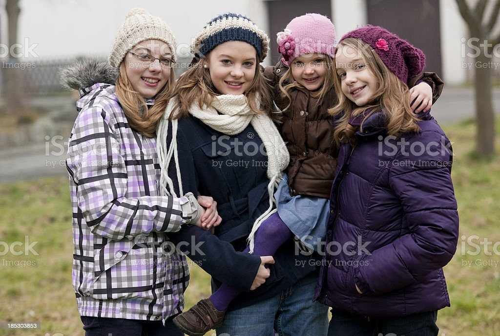 Four sisters outdoor royalty-free stock photo