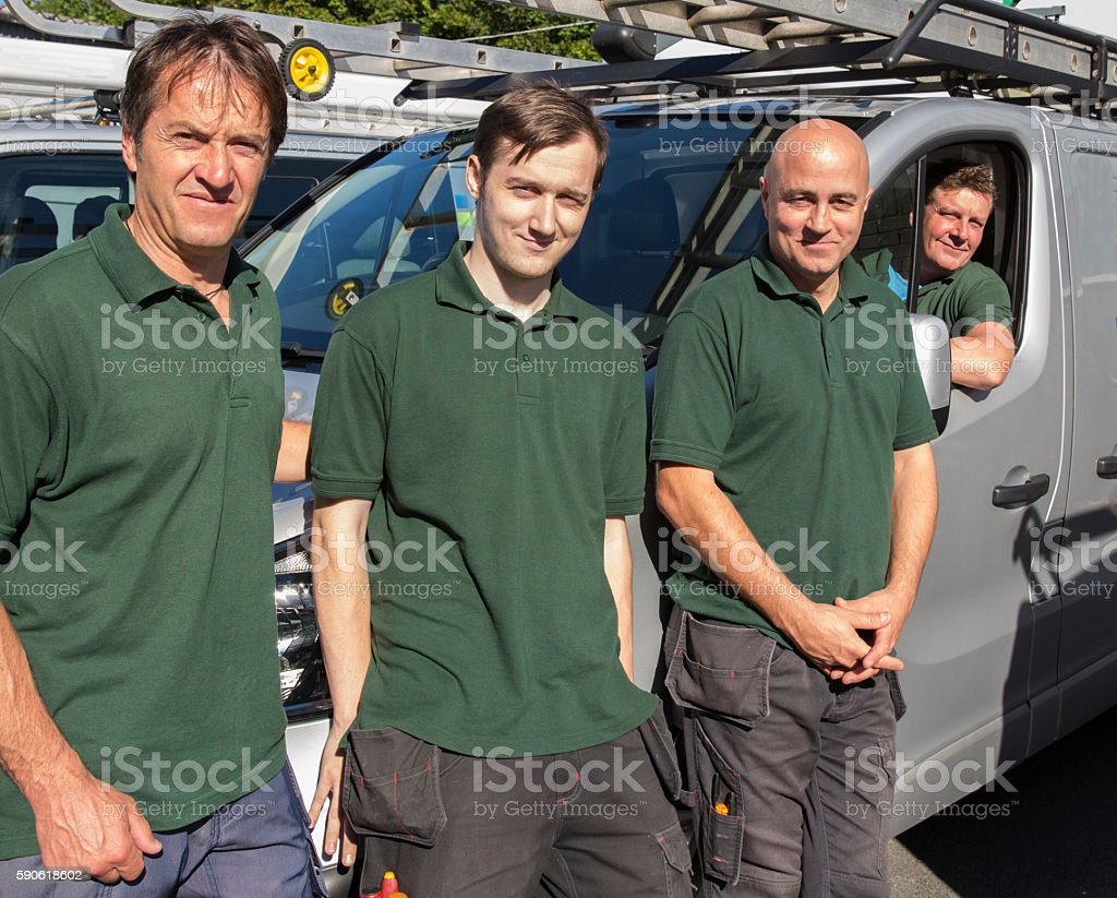 Four site men on a building site preparing for work stock photo