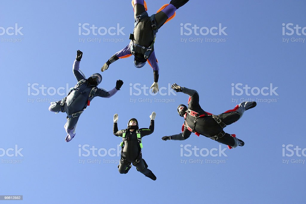 Four Skydivers building a star formation royalty-free stock photo