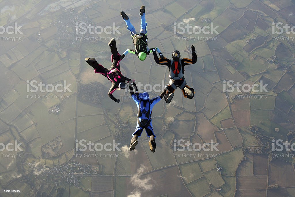 Four skydivers in freefall royalty-free stock photo