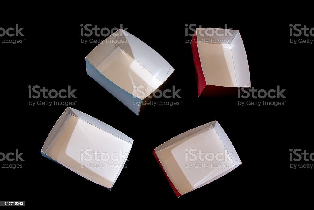 four small boxes made of laminated paper stock photo