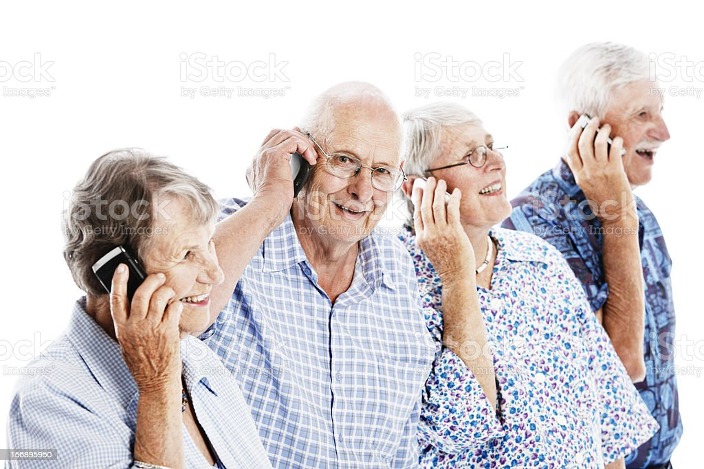 Four smiling seniors keep in touch on mobile phones royalty-free stock photo