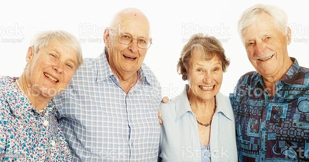 Four smiling seniors, two men, two women, in a line stock photo