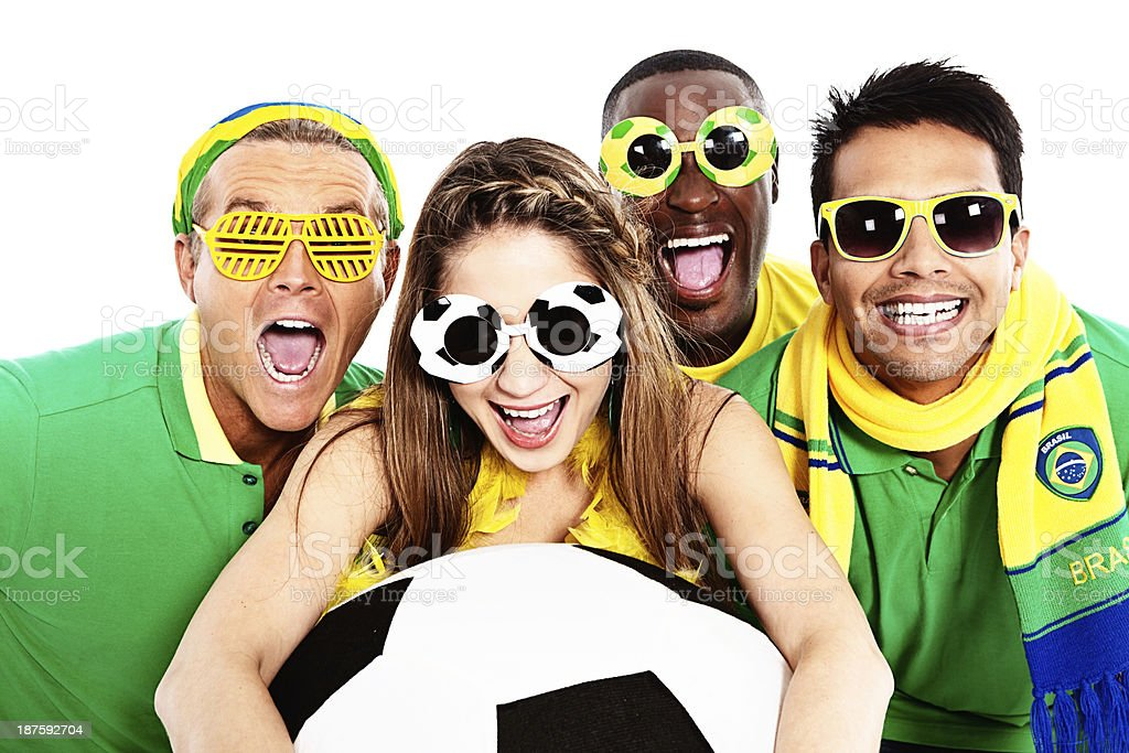 Four soccer fans in funky sunglasses cheer on their team royalty-free stock photo