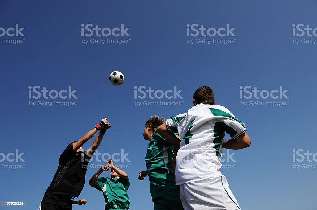 Four soccer players in the action royalty-free stock photo