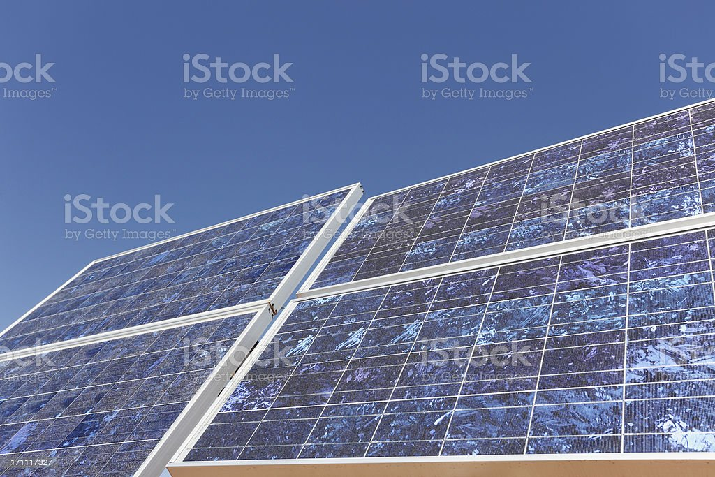 four solar panel front view against perfect blue sky royalty-free stock photo