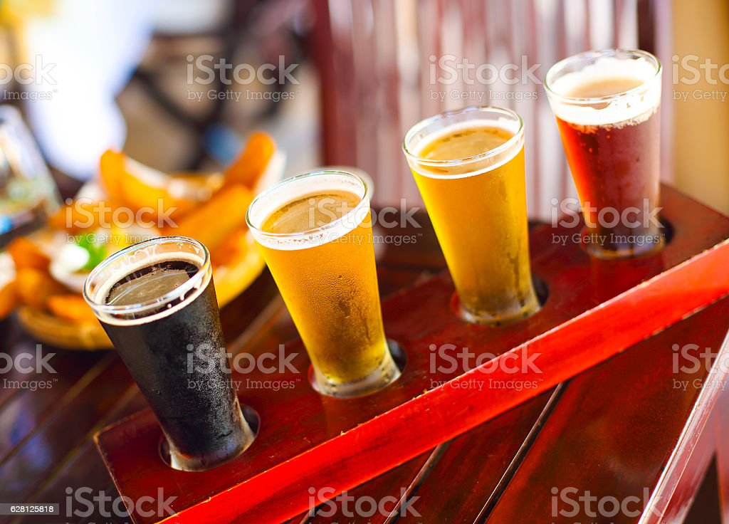 Four sorts of beer. Beer tasting. Ale, porter, lager, pilsner stock photo