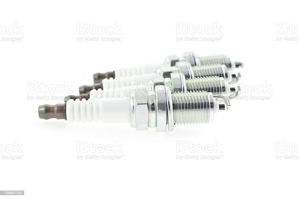 Four Spark Plugs on a white background royalty-free stock photo