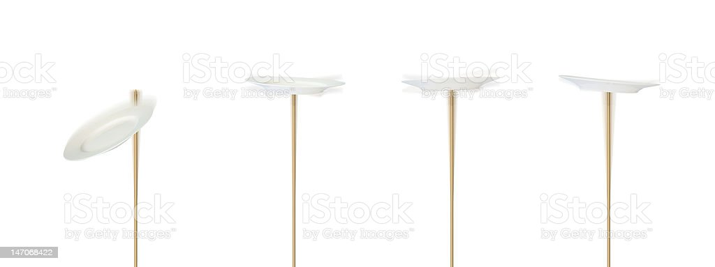 Four spinning plates stock photo