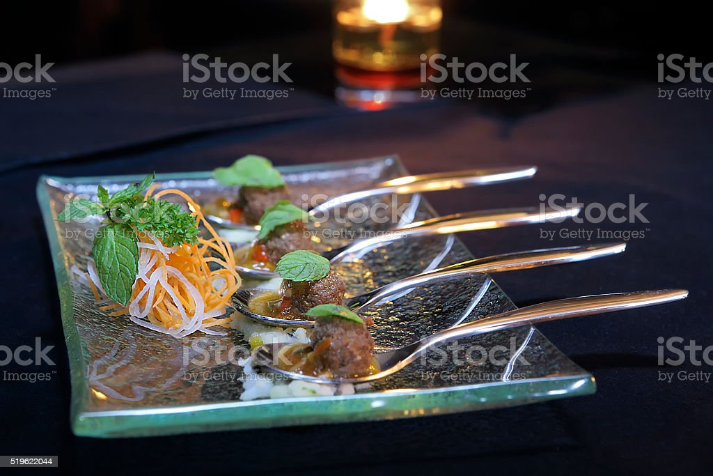 Four Spoons Of Meatball stock photo