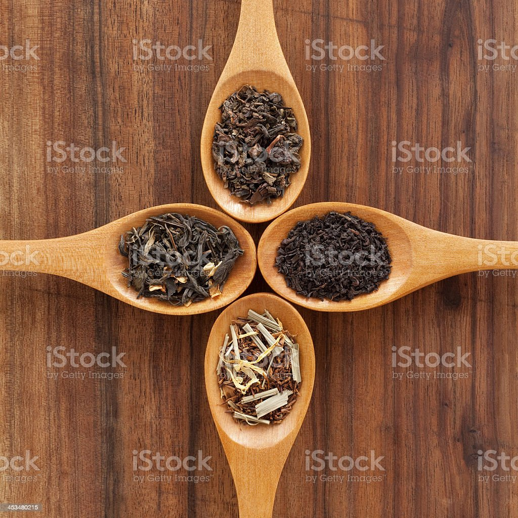 Four spoons with loose teas royalty-free stock photo