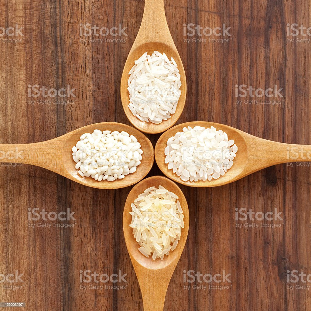 Four spoons with white rices stock photo