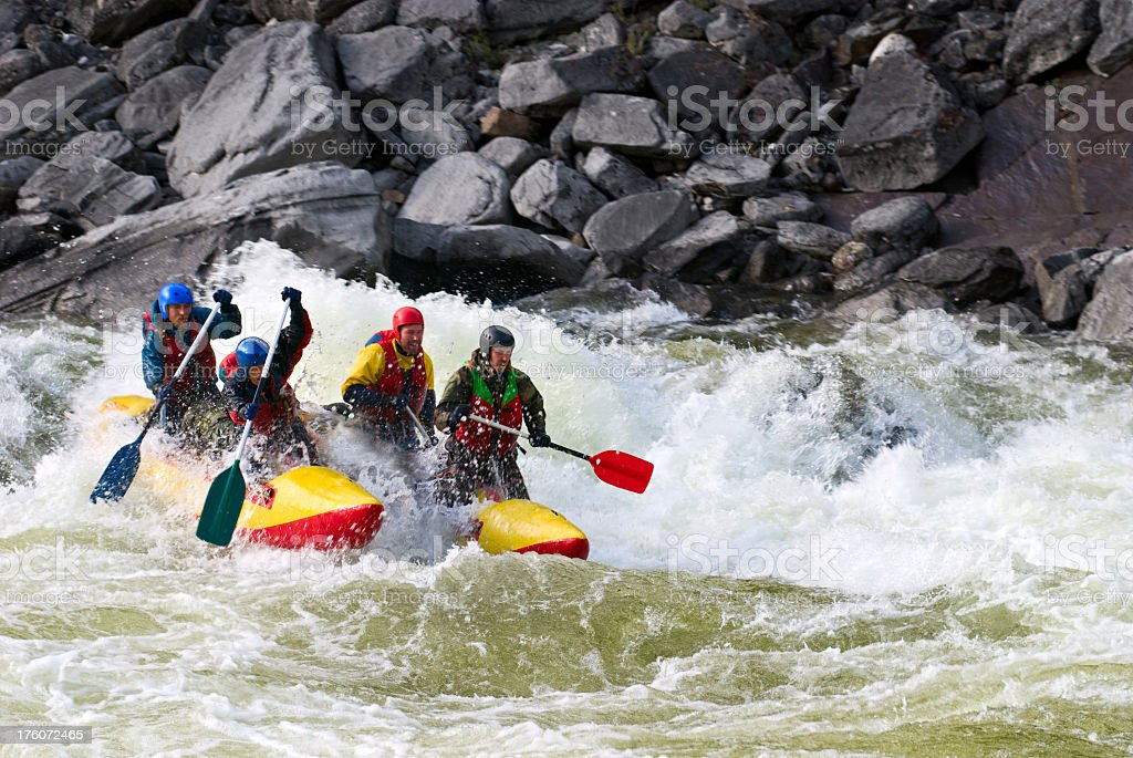Four sportsmen float on the dangerous mountain river royalty-free stock photo