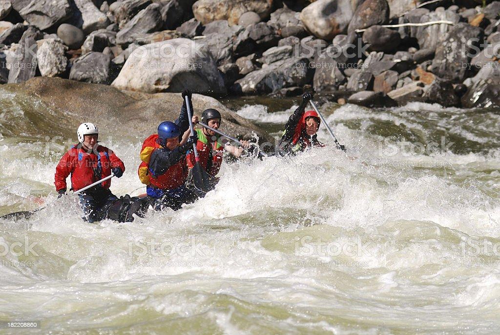 Four sportsmen float on the dangerous mountain river stock photo
