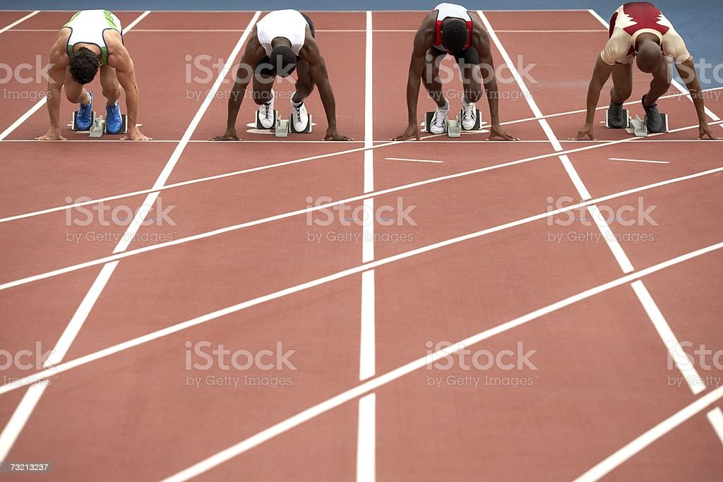 Four sprinters on a race track royalty-free stock photo