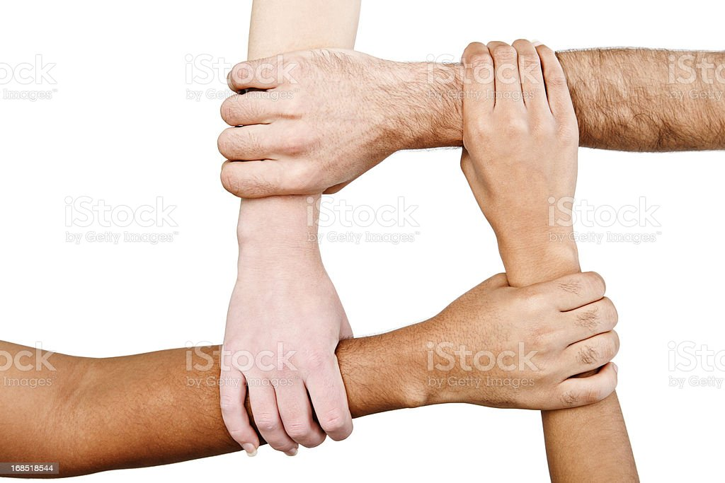 Four square! Interracial hands linked in unity royalty-free stock photo