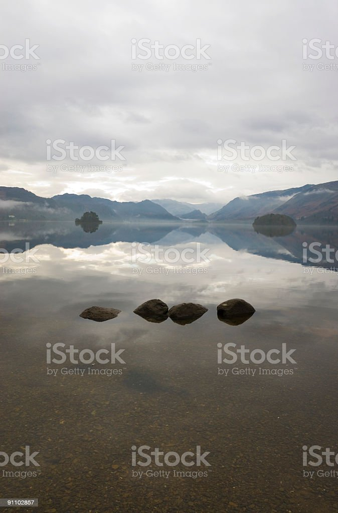 Four stones, two islands, one sky royalty-free stock photo