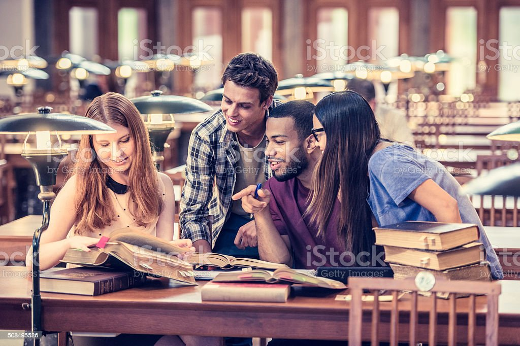 Four students studying and having fun stock photo