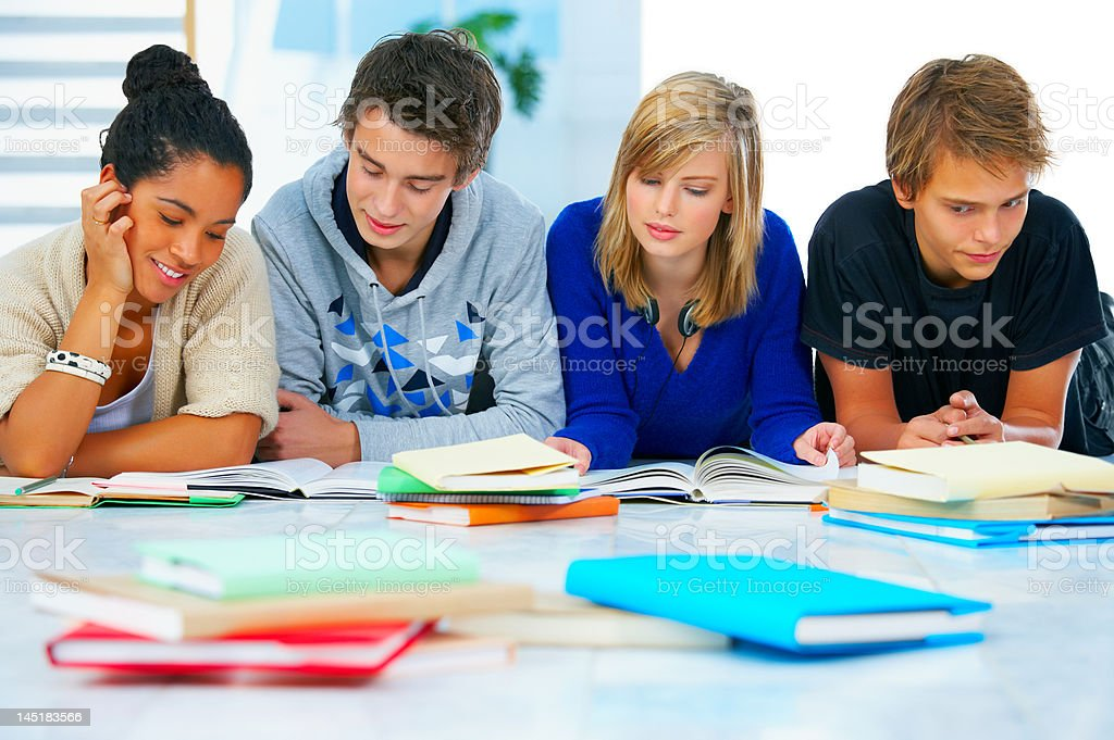 Four students studying together royalty-free stock photo