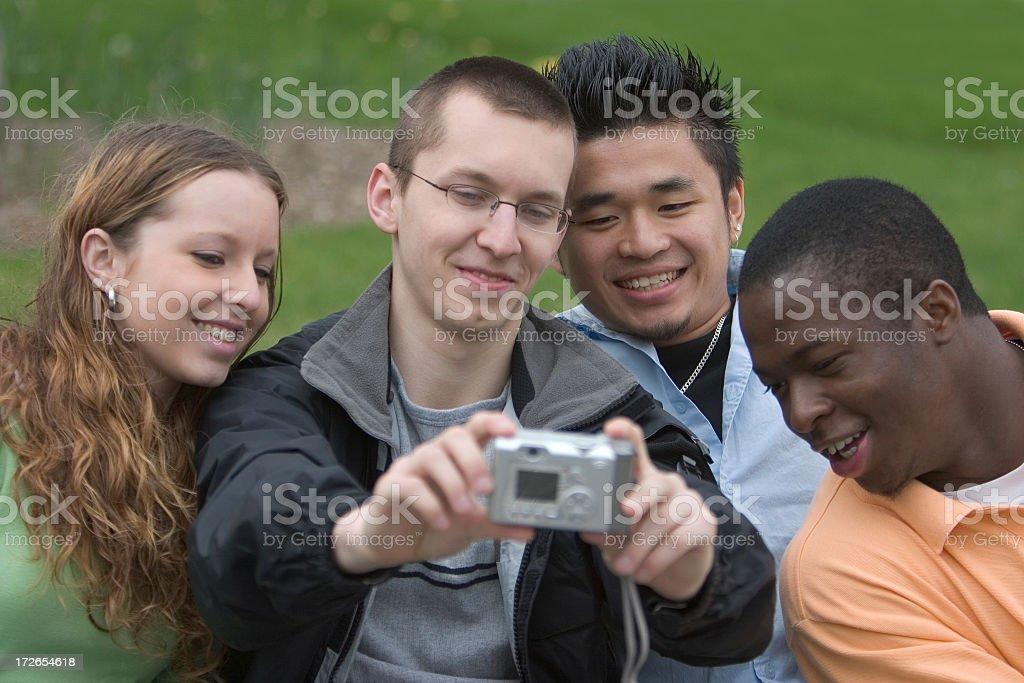 Four students taking a photo stock photo
