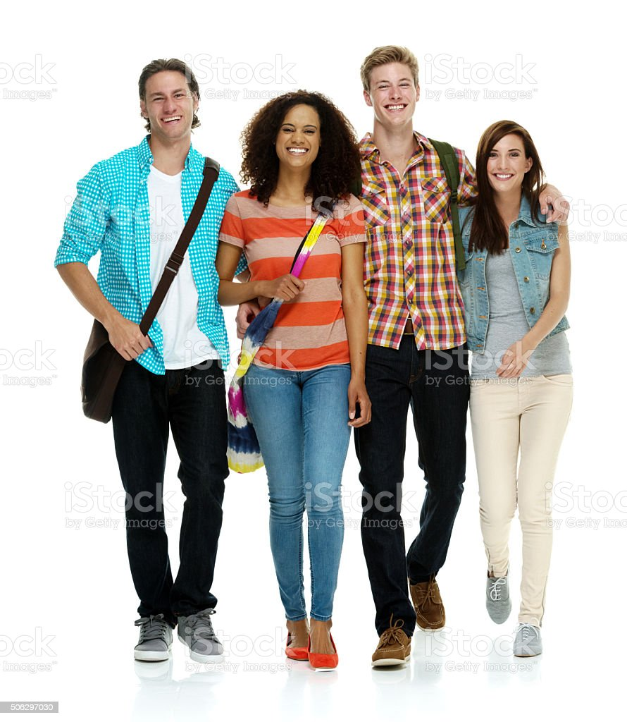 Four students walking together stock photo