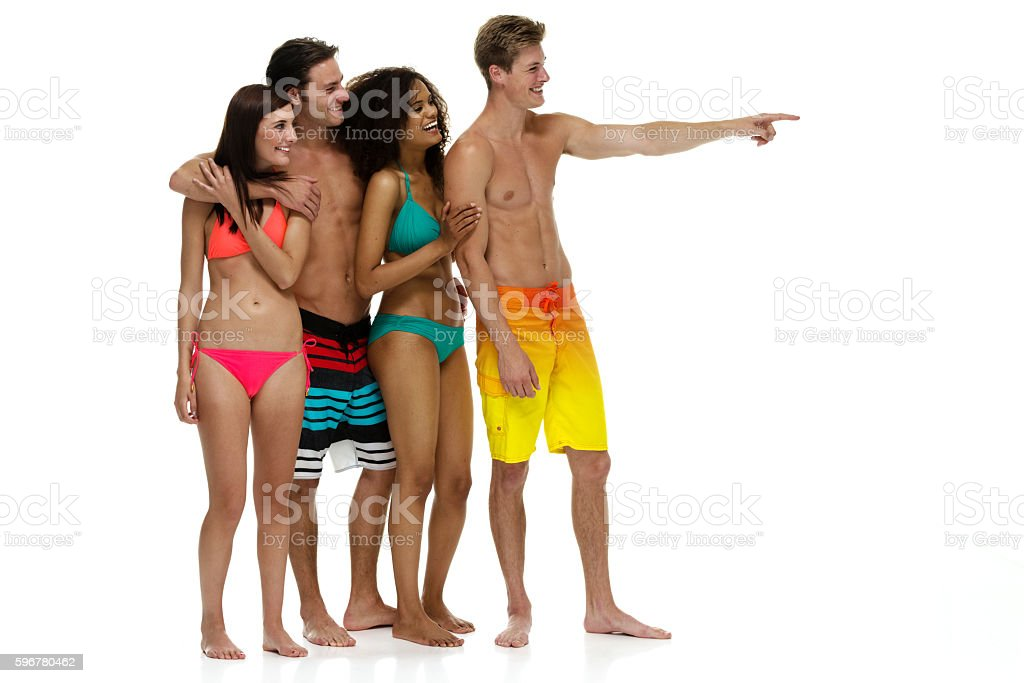 Four swimmers pointing away stock photo