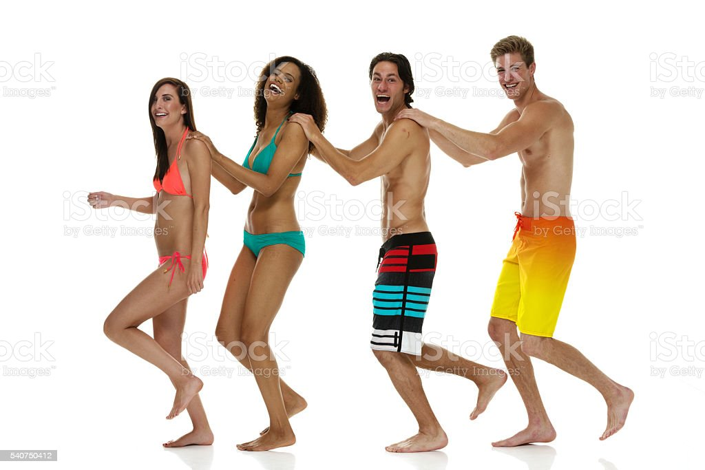 Four swimmers walking together stock photo