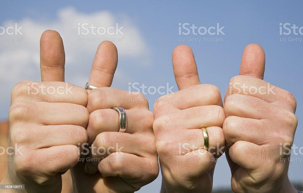 four thumbs stock photo