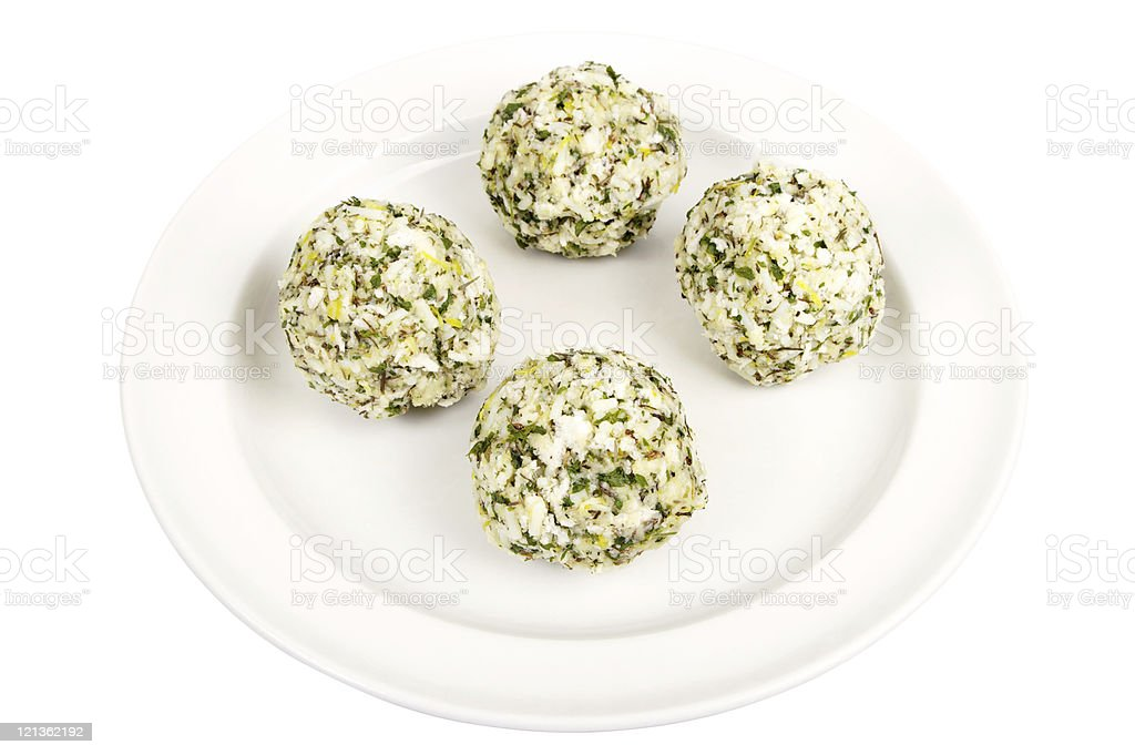Four Thyme And Parsley Stuffing Balls On A White Plate royalty-free stock photo