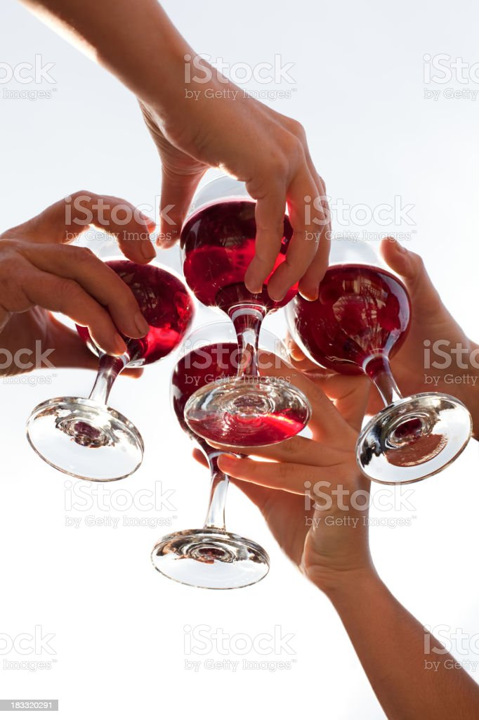 Four toasting glasses of red wine royalty-free stock photo