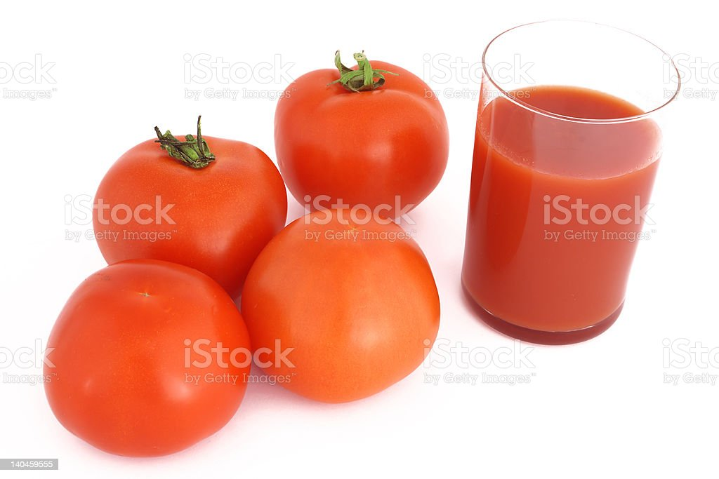 four tomatoes and glass of tomato juice royalty-free stock photo