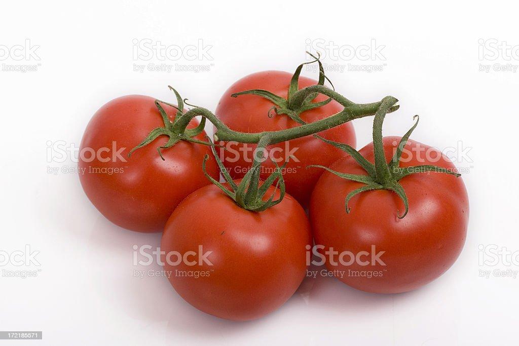 Four tomatoes royalty-free stock photo
