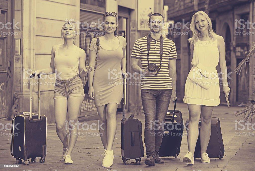 four tourists taking walk stock photo