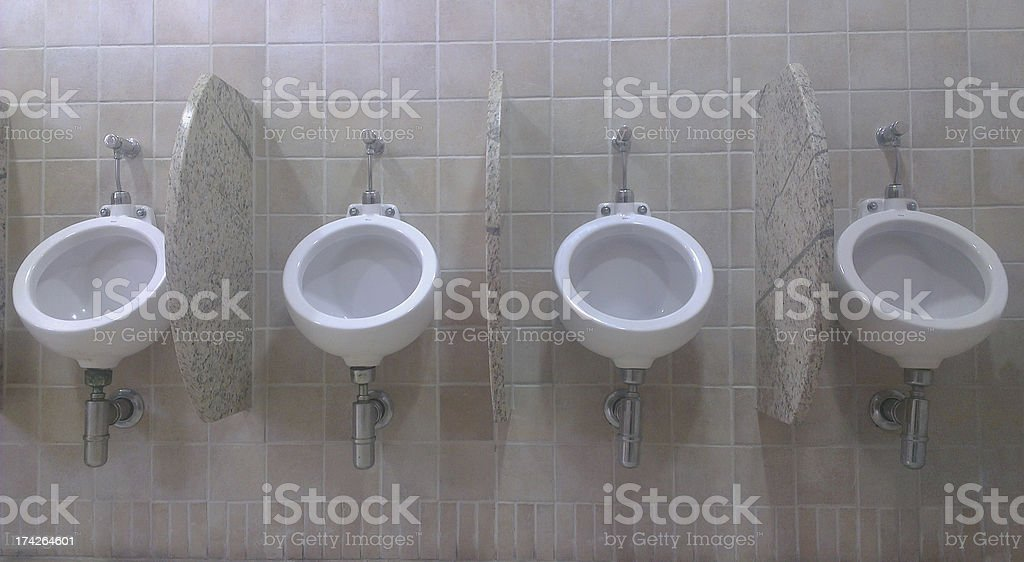 four Urinals royalty-free stock photo