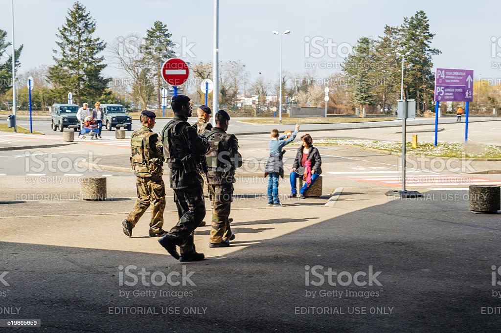 Four vigipirate soliders inspecting the French Airport stock photo