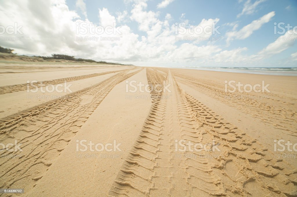 Four wheel drive tracks in the sand stock photo