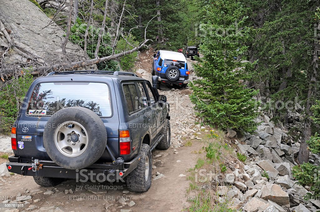 Four wheel drive truck negotiating rough road stock photo