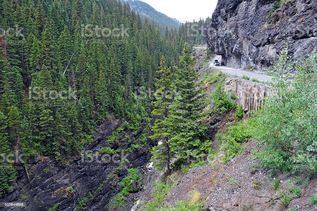 Four wheel drive vehicles on dangerous exposed Shelf Road stock photo