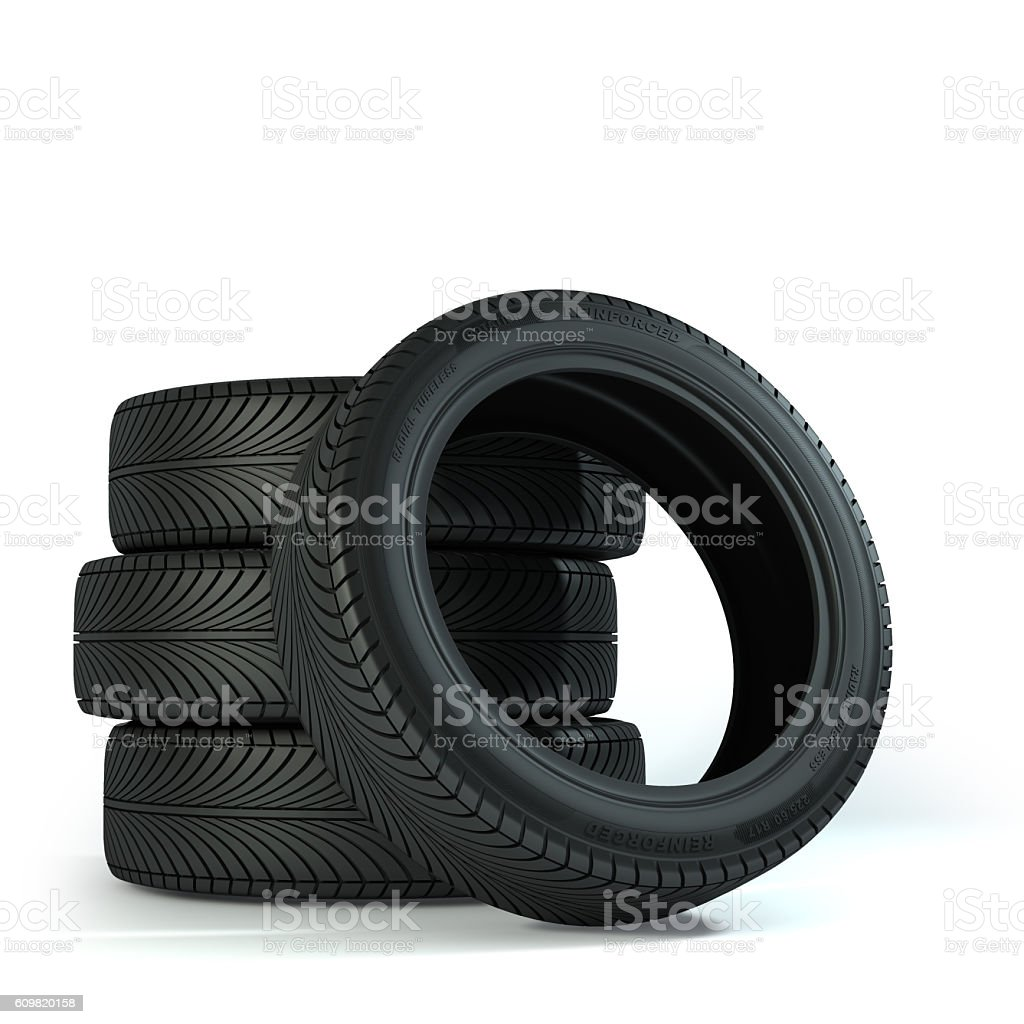Four Wheels over the white background. Group of automotive tires stock photo