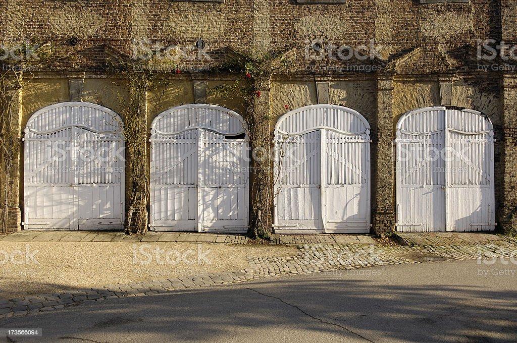 Four white doors to choose stock photo